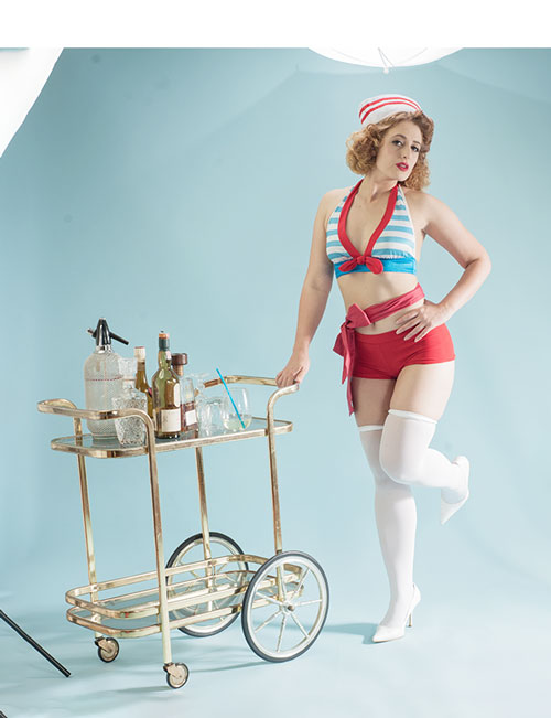 During the photo shoot - a woman dressed in a sailor outfit.
